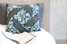 blue quilted pillow